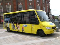 The yellow Buses4U bus at a publicity event