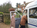 Two ladies boarding a minibus for a shopping trip